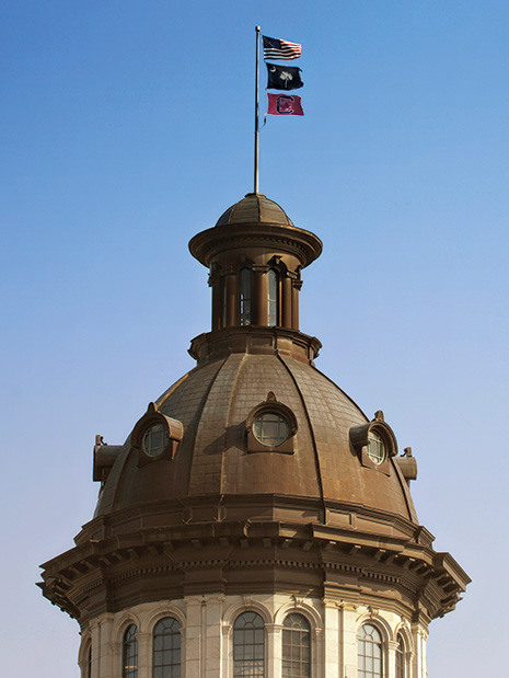 statehouse dome with flags flying