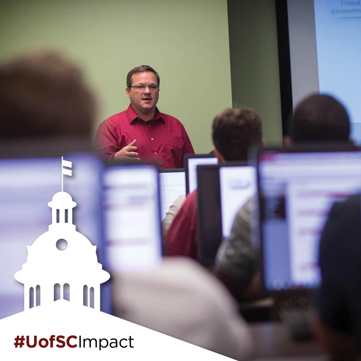 professor in classroom #UofSCImpact